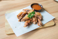 Buffalo chicken wings. Hot  Fried Chicken Wings with Garlic Royalty Free Stock Photos