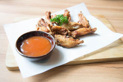 Buffalo chicken wings. Hot  Fried Chicken Wings with Garlic Royalty Free Stock Images
