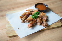 Buffalo chicken wings. Hot  Fried Chicken Wings with Garlic Stock Photos