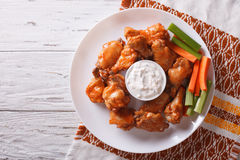 Buffalo chicken wings with sauce and celery.horizontal top view Stock Photo