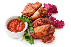 Buffalo chicken wings. Chicken wings with sauce, greens and herbs on White Background stock image