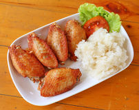 Buffalo chicken wings with sticky rice Royalty Free Stock Images