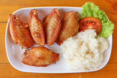 Buffalo chicken wings with sticky rice Stock Photography