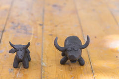 buffalo clay sculpture on wooden background in outdoor royalty free stock images