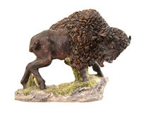 Buffalo Figurine. Buffalo on a hill - figurine with white backgroung Royalty Free Stock Photos