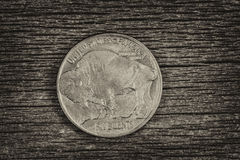 Buffalo Nickel on aged wood Stock Photo