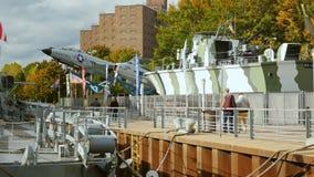 Buffalo, NY, USA - OKTOBER 20, 2016: Tourists walk around jet aircraft and landing craft. Buffalo and Erie country Naval stock video
