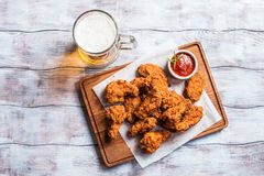 Buffalo style chicken wings. Served with cold beer, top view with copy space Royalty Free Stock Photo