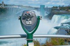 BUFFALO, USA, OCT, 24, 2013: View on Niagara fall stationary observation optical binocular to watch waterfall of Buffalo city, and royalty free stock photo