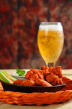 Buffalo Wings. Buffalo style chicken wings served with cold beer Royalty Free Stock Photography