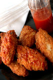 Buffalo wings. Barbecue buffalo wings and hot sauce Stock Images