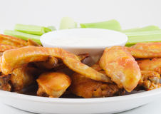 Buffalo Wings. Plate of buffalo wings, celery and blue cheese dressing Royalty Free Stock Photos