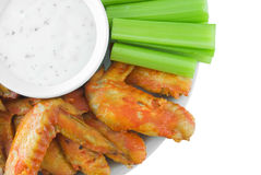 Buffalo Wings. Plate of buffalo wings, celery and blue cheese dressing isolated on white Stock Image