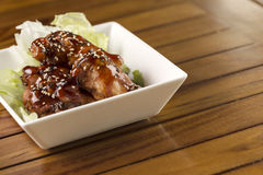 Buffalo Wings. Barbecue buffalo wings with sesame sauce ready to be served Stock Photos