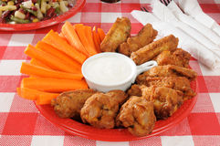 Buffalo wings and carrots Stock Images