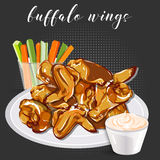 Buffalo wings, celery with carrot and blue cheese in a bowl. Stock Photography