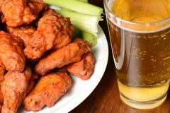 Buffalo Wings. With Celery Sticks and Beer royalty free stock images