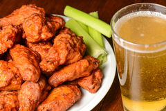 Buffalo Wings. With Celery Sticks and Beer stock image