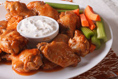 Buffalo wings with cheese sauce and vegetables close-up. horizon Royalty Free Stock Photos