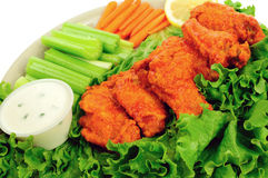 Buffalo wings and dip. Delicious buffalo chicken wings served with celery, carrots and chunky blue cheese dip stock photo