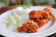 Buffalo wings , Fried chicken with hot and spicy sauce stock images