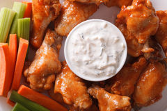 Buffalo wings with sauce on a plate macro. horizontal top view Stock Photo