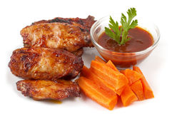 Buffalo wings set. Chicken Buffalo Wings with carrot sticks and hot tomato sauce dip over white background stock photos