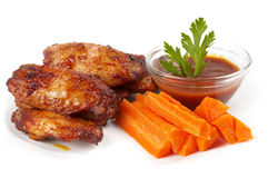 Buffalo wings set. Chicken Buffalo Wings with carrot sticks and hot tomato sauce dip over white background royalty free stock photo