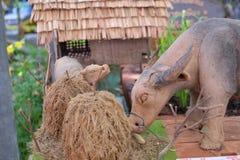 Buffelsbeeldhouwwerk en rijststro Royalty-vrije Stock Afbeelding