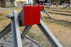 Buffer stop with red painting closeup view on old railroad royalty free stock image