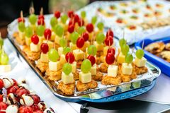 Buffet Assortment of canapes. Banquet service. catering food, snacks with mixed fingerfood appetizers royalty free stock photos