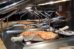 Buffet on the cruise ship. Sliced pizza slices Royalty Free Stock Images