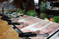 Buffet on the cruise ship. Sliced sausage, ham and cheese Stock Photo