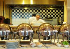 Buffet dinner at restaurant. Buffet food dinner at restaurant, show kitchen at background Stock Images