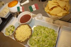 Buffet of dishes of Mexican food. Decorated with flag, in restaurant self service stock photo