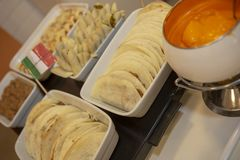 Buffet of dishes of Mexican food. Decorated with flag, in restaurant self service stock image