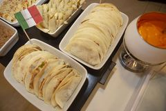Buffet of dishes of Mexican food. Decorated with flag, in restaurant self service royalty free stock photography