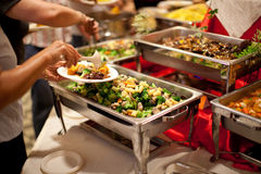 Buffet Eating. Close-up of a loaded plate at a buffet Stock Photography