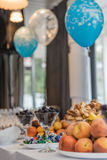 Buffet at event with desert, fruits and balloons Stock Photo