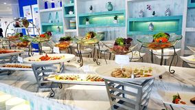 Buffet with fresh dishes at the catered buffet table decorated beautiful. slow motion. 1920x1080