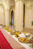 Buffet in hallway. A long buffet spread is set up in a luxurious hallway Stock Photography