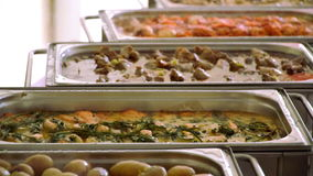 Buffet: hot and side dishes are on the table stock video footage