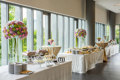 Buffet line. In luxury party decoration with beautiful flower bouquet Stock Photography