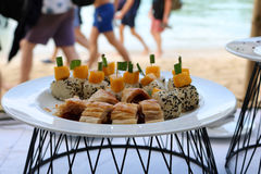 Buffet lunch set on the beach. Royalty Free Stock Photos