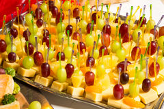 Buffet with pineapple and grapes appetizers and other fruits in restaurant Stock Photo