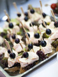 Buffet plate with cheese and olives Royalty Free Stock Photo