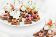 The buffet at the reception. Assortment of canapes. Banquet service. catering food. Snacks with fish, vegetables and meat. rye, wheat bread Royalty Free Stock Images