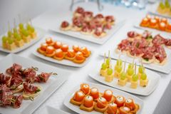 Buffet at the reception. Assortment of canapes. Banquet service. catering food, snacks with salmon stock photos