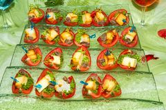 Buffet reception finger food appetizers with sardines. Royalty Free Stock Photo