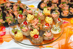 Buffet reception finger food appetizers with smoked salmon servi Stock Images